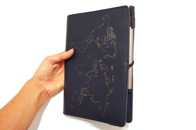 Elasticated pen holder keeps notebook & pen stored together
