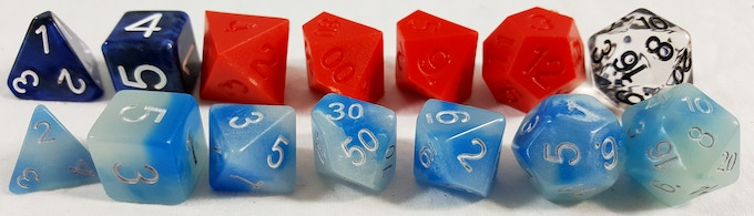 Our dice to this point in V3 (back) compared with standard dice (front)