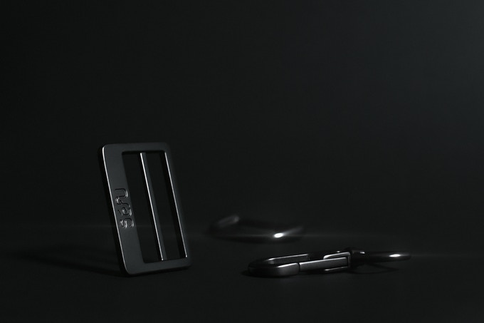 A photo of our custom matte gunmetal hardware that will ship with the Pro and Standard Switch Bags.