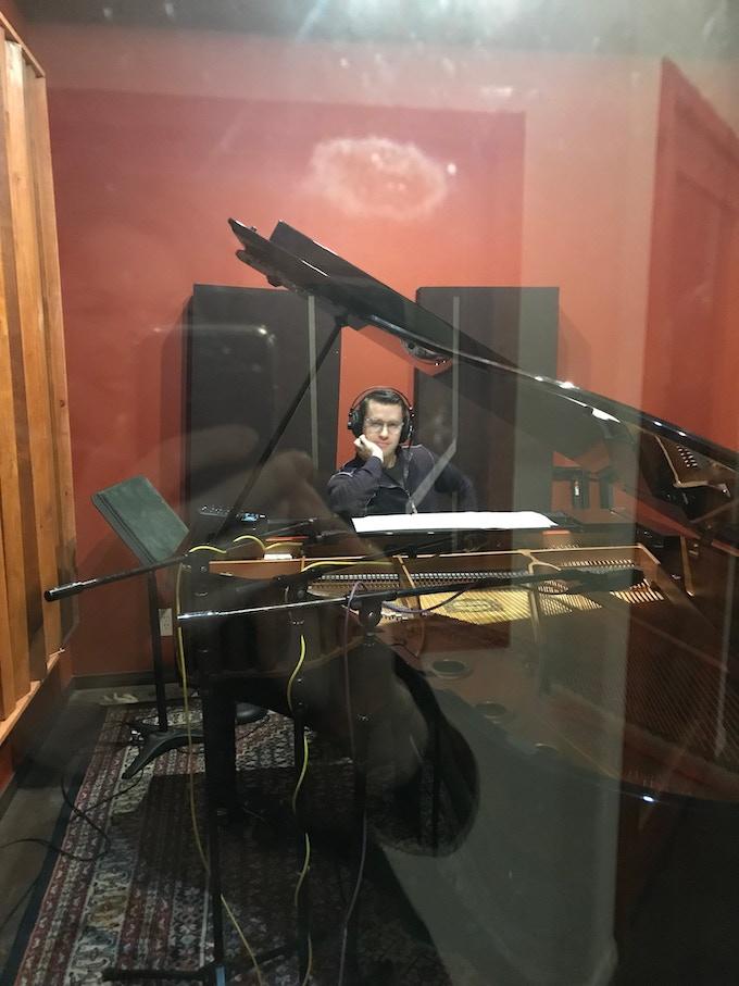 Misha Bigos pensive at the piano during the recording session.