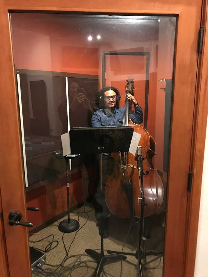 Nick Ornelas on upright bass in the recording session.