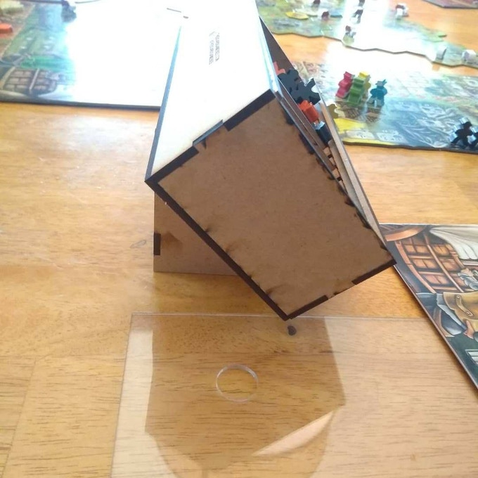 Image of the KICK STAND  accessory .  Holds boxes at an angle to better see game pieces during play.