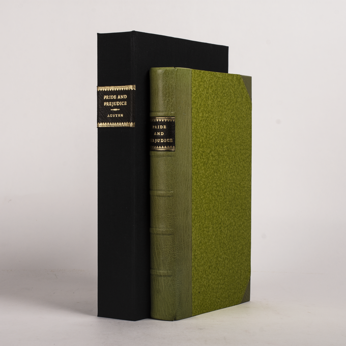 PRIDE AND PREJUDICE bound in half-leather and pastepaper boards.