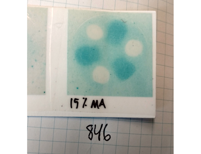 Laboratory swatch of light sensitive ink distinguishing between HEV and UV