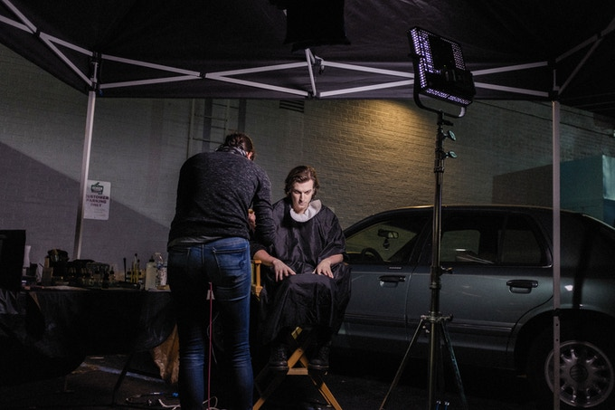 Actor Peter Vack gets into SPFX makeup and prosthetics, applied by SPFX Makeup Artist Mo Meinhart, outside the diner location in Savannah, GA