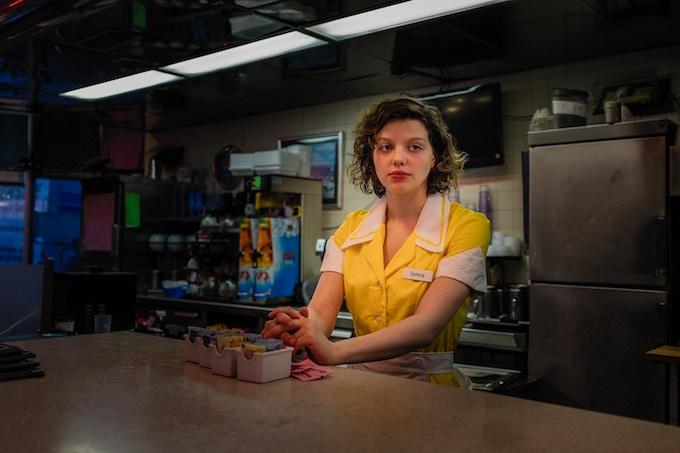 Lead actor Chloë Levine awaits a heavier diner flashback scene at sundown