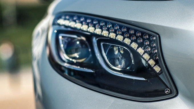Crystal LED Headlight with Exposed Yellow Phosphor During Light Off Mode