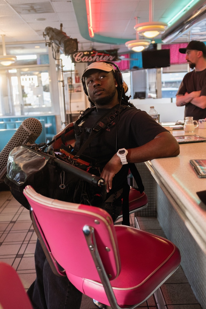 Production Sound Mixer, Tres Savid, kicks back in between takes at the diner location