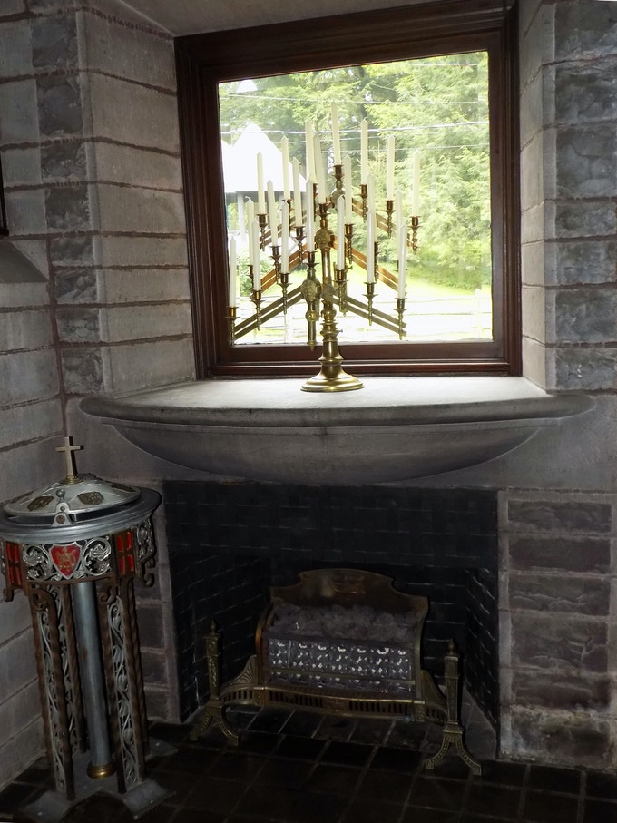 This stone fireplace in the dining room dates back to 1891 and the baptismal font on the hearth came from an old church that had been demolished. The innkeeper's husband found it in the woods near the church and saved it.