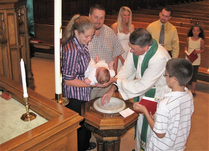 The baptism of my daugher, Allana, performed by Pastor Schaeffer