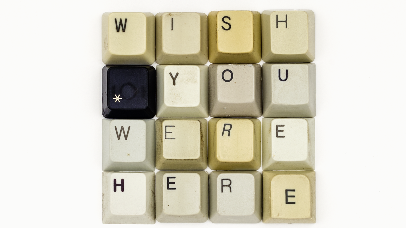 """This project is about creating the  28th Typographic Postcard that says """"WISH YOU WERE HERE"""" set in used keyboard keys."""