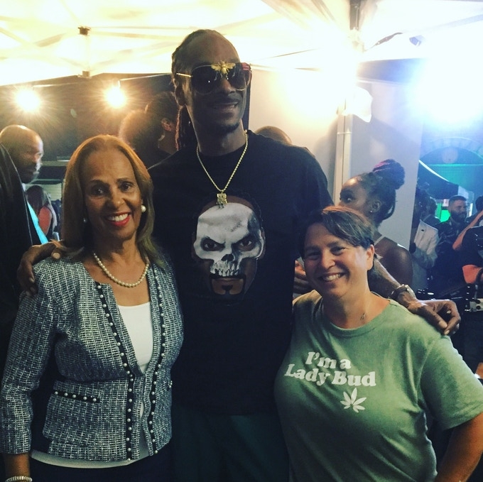 Lady Bud Sue Taylor and Director Russo meet Snoop Dogg at the Smoke 4 A Cure Cancer Benefit in Los Angeles