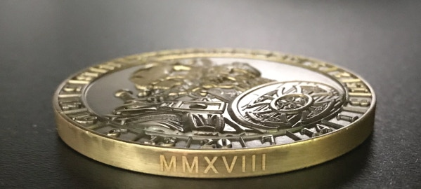 LImited Edition Engraving. For the first year a coin is minted, the year is engraved in Roman Numerals on the edge.  The same coin produced in later years will not have this engraving.