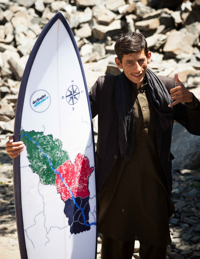 The Panjsher-board hold by one of the local spectators, after our first surf session in Afghanistan.  We'd like to give you this historic board as a perk for your support