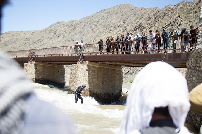 Surfing the Panjsher river in Afghanistan