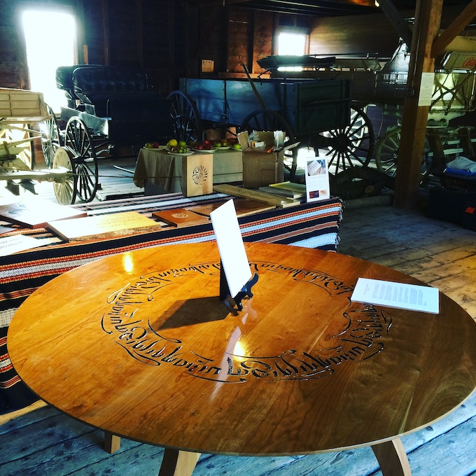 Yes, this is the big one, the epic: seen here at the Vermont Woodworking and Fine Furniture Show, the Tibetan Table, constructed without a single nail or screw by woodworker Tim Peters, carved by the other Tim, Tim Brookes of the Endangered Alphabets. People who see it gasp.