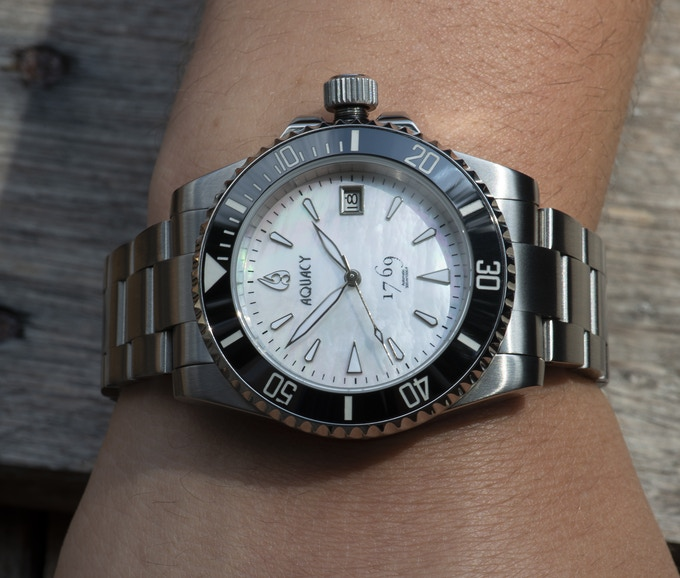 White Mother of Pearl Dial.  Ceramic Bezel Comes Standard on All Aquacy 1769 Series.
