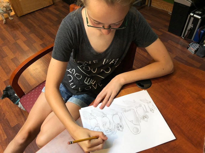Renee, 360Rize owner, Mike Kintner's daughter, drawing the initial concept drawing. From the concept, we created a family of animated characters to help present our 360Penguin stories.