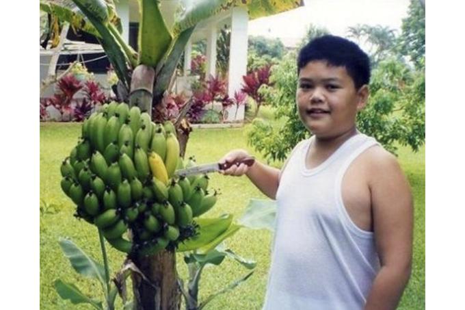 Yup, that's me at around age 10 poking a banana.