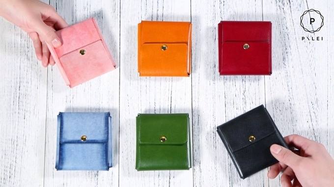 Stylish leather wallet with unique design to hold your cash, cards and coins.  Free custom monogram and RFID blocking card.