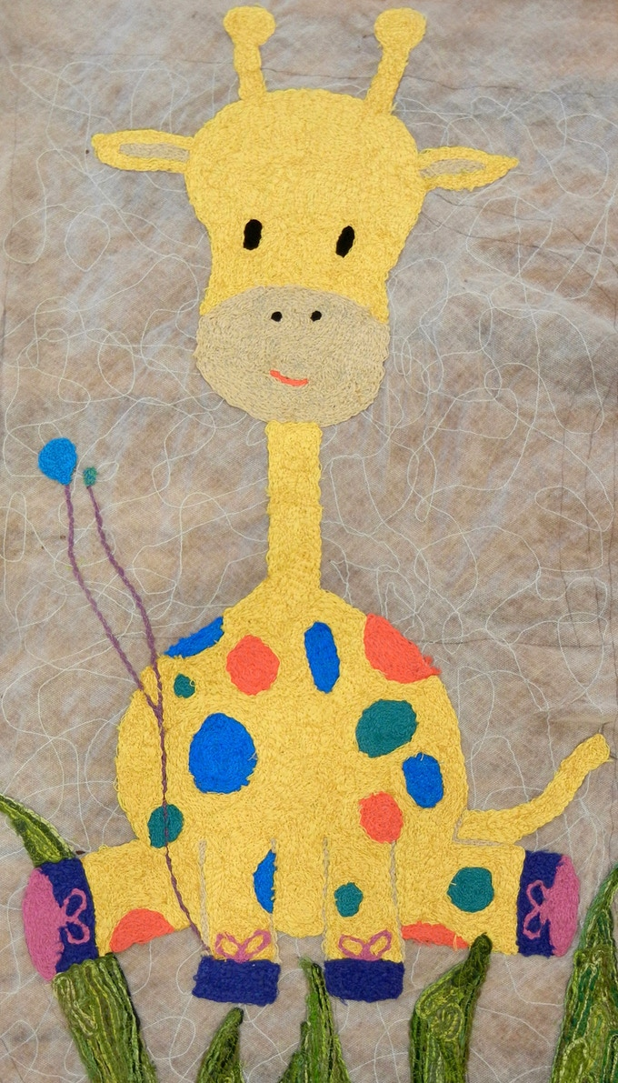 Sylvia giraffe, balloons she is holding are the size of her tumor before her craniotomy and after. She also gets to pick a balloon after each major appointment.