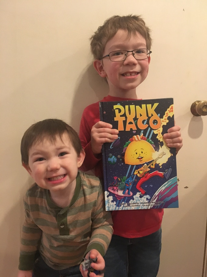 Makana and his little brother showing off their copy of Punk Taco Volume 1
