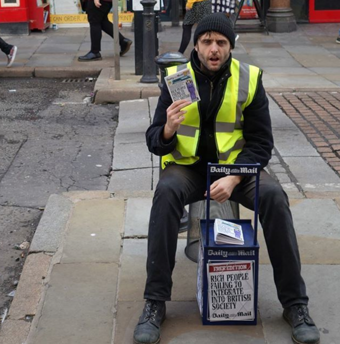 Me giving out the paper in Liverpool