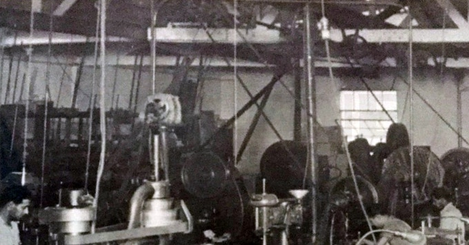 Technology changes slowly over time.  The above picture, given to me by my godfather, is of a Southern California machine shop circa late '30s (his father worked in this shop).  Notice the drive belts coming from the drive shaft at the ceiling.  A single gas powered engine drove this shaft which then drove all of the machines (lathes, milling, etc.)  No electrical power!  How far we've come!