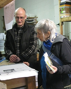Eberhardt Press publisher Charles Overbeck inspects a cover proof with Judith.