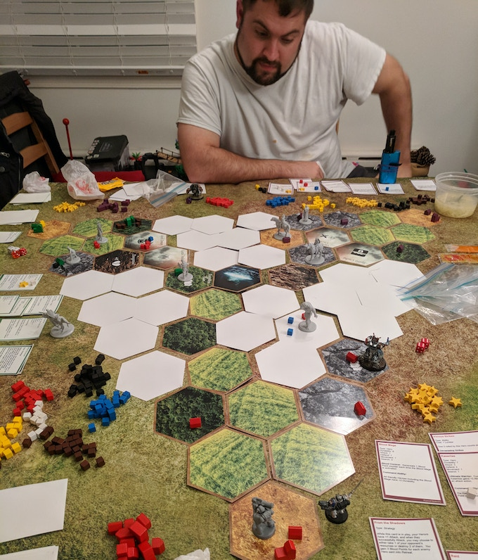 Where it all began! One of our earliest prototype playtests, still using some proxy minis. Neil is very deep in thought!