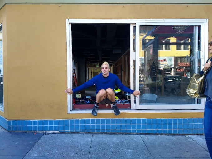 Sitting on the windowsill at 16th and Valencia