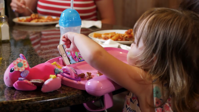 In the above image the tray is holding a smaller media device while dining.