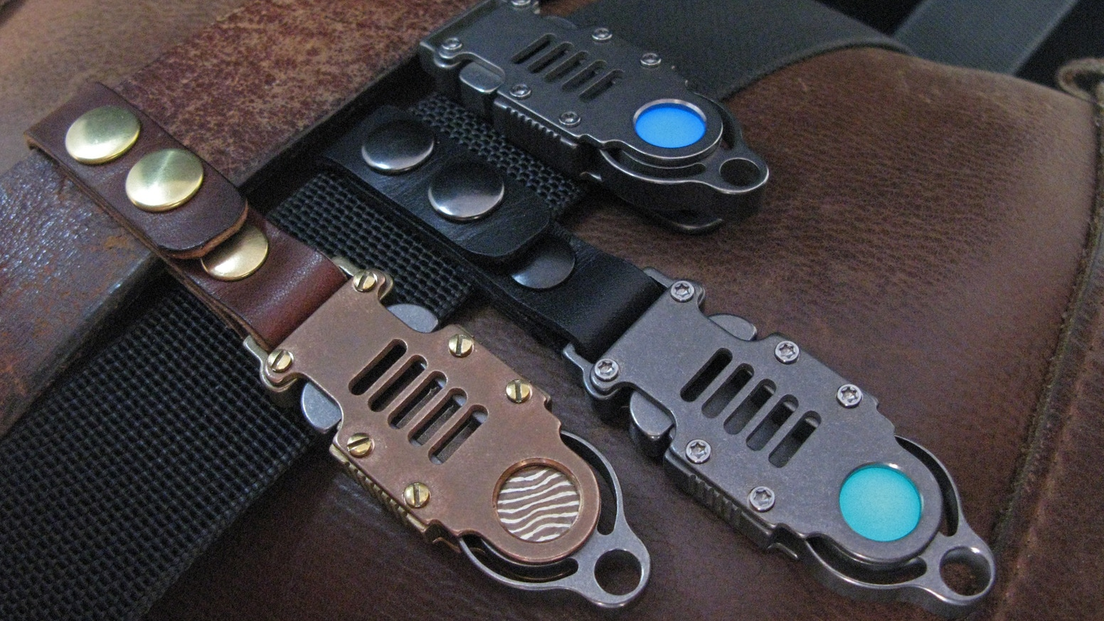 An EDC key & gear retention system from raw Titanium and Aerospace Grade 7075T61.  Clip or Strap.  Numerous inserts to choose from.