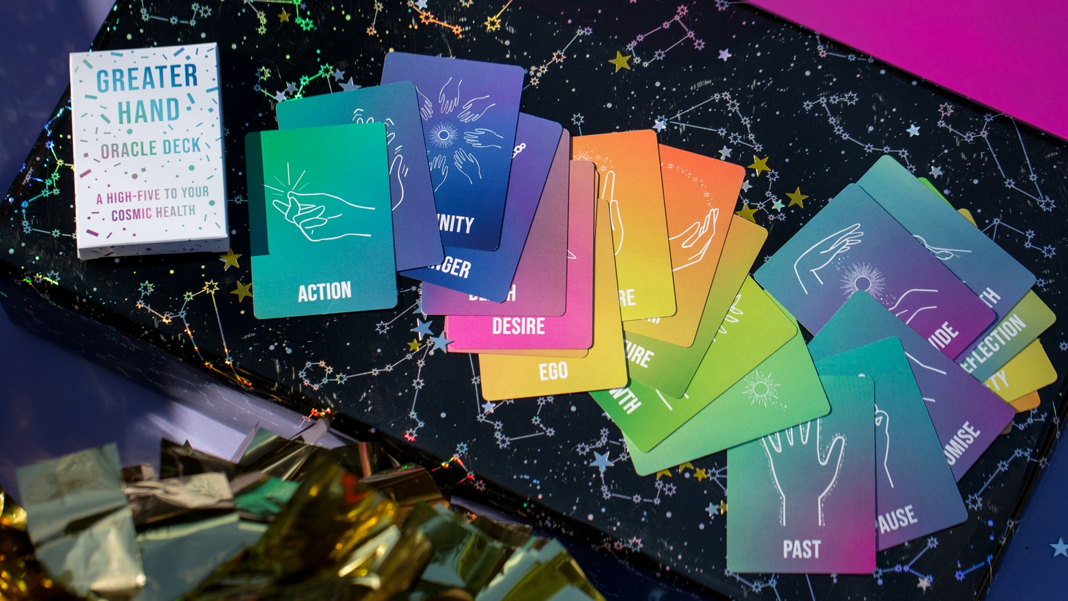 25 cards that represent a theme word with illustrated hands, set against a colorful background. Your cosmic health check-in awaits...