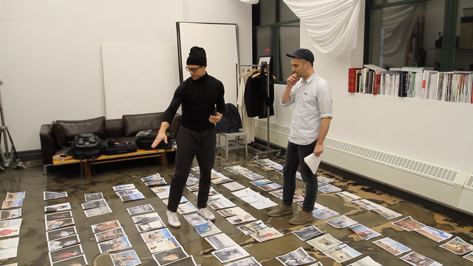 Designer Matt Willey (right) and I working out the book spreads on the floor of my Brooklyn studio.