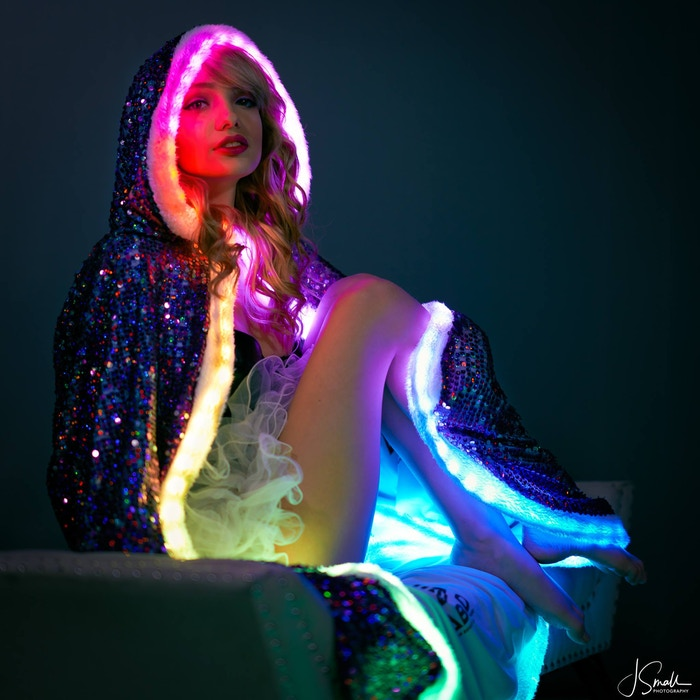 Experience the future of party costumes! Smart LEDs, holographic sequins, remote-control lighting effects, multi-cloak sync & more...