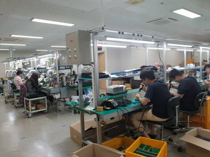 Various parts being assembled in the factory.