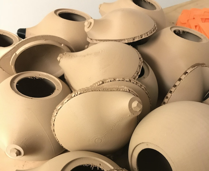 """Unfinished raw 3D printed speaker housings, printed in """"wood"""" material with excellent audio qualities."""