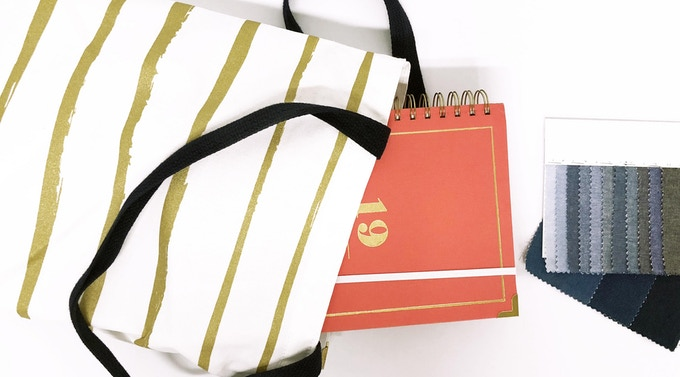 cutie coral planner in our paint stripe tote