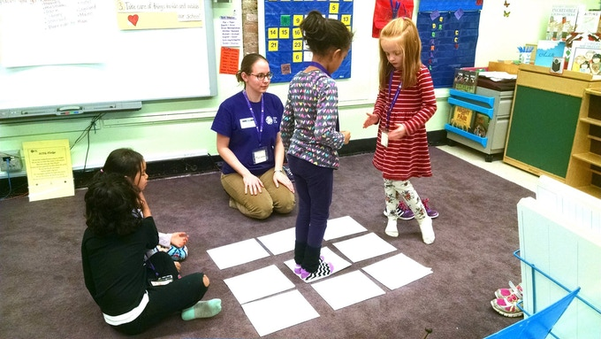Marianna leads girls through an exercise about coding.