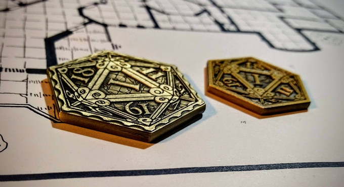 Epic D20 coin (left), Original D20 coin (right). Photo and map credit: Dyson Logos