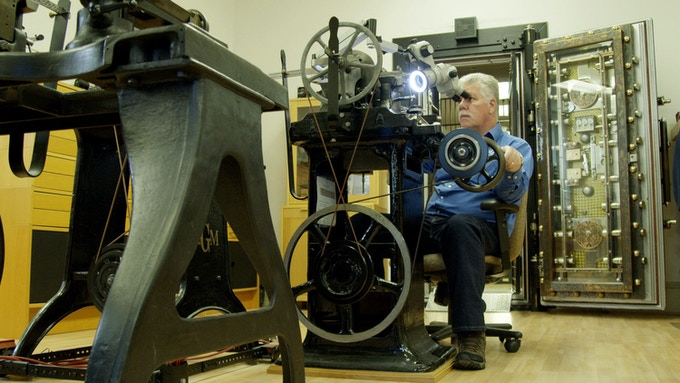 American watchmaker Roland Murphy hand cranks one his antique rose engines to engrave a watch dial.