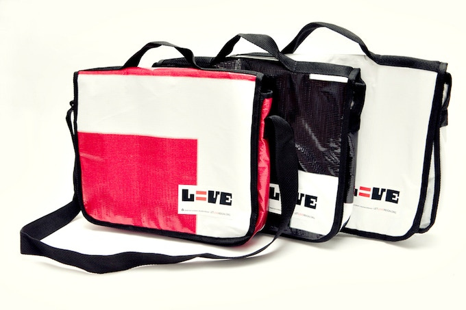 Let Love Reign messenger bags made from the billboard that featured Tim & Ron. Said billboard was displayed in Charlotte the entire month of October, 2010.