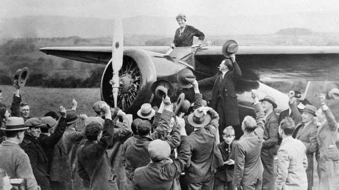 Amelia Earhart arrives in Culmore, Northern Ireland after her solo flight across the Atlantic after fighting fatigue and aircraft problems