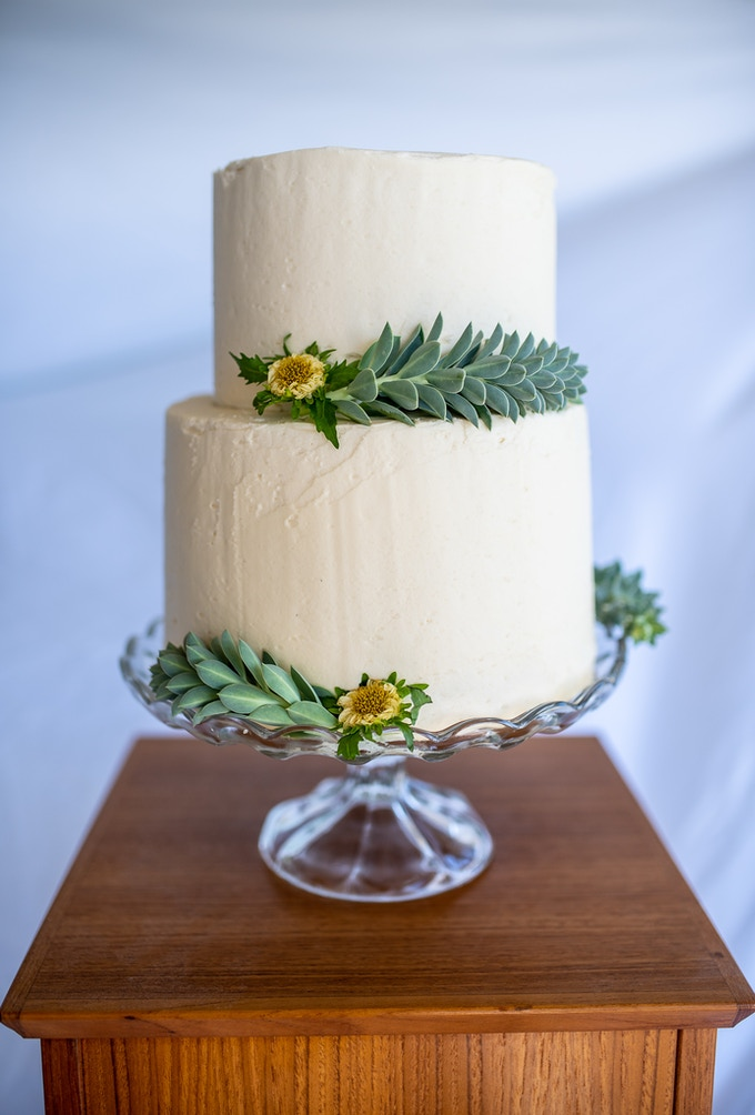 Basic two-tier buttercream wedding cake.