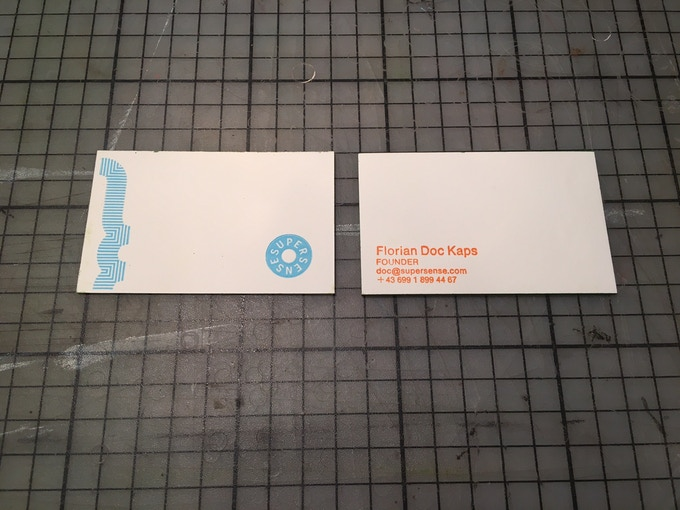 Up to 4 lines of your text, printed on one side and a special all analog design at the front!