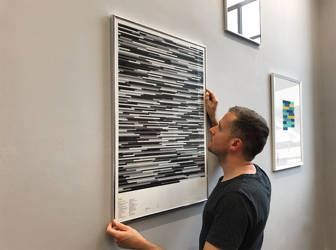 Alex hanging a discography of The Fall (A1, Mono)