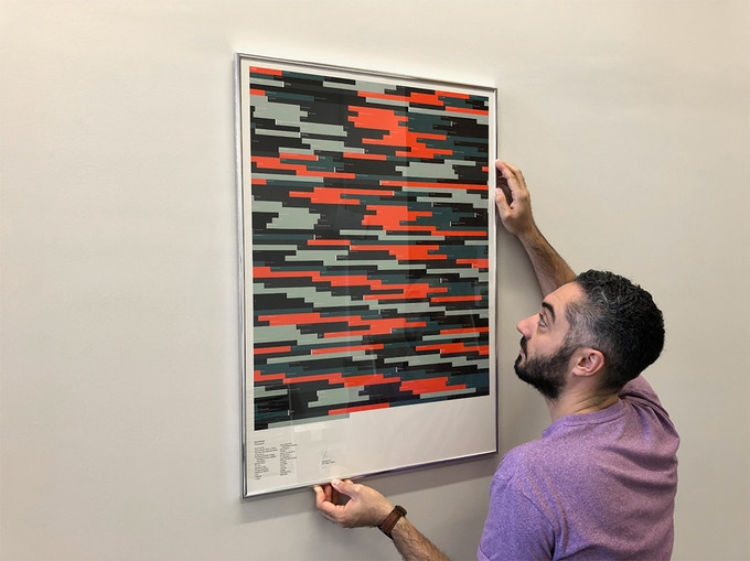 James hanging David Bowie's discography (A1, 8-Bit)