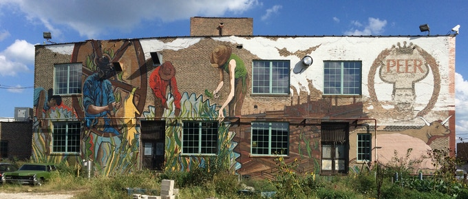 Mural on the exterior of The Plant; artist Joe Miller will also design and implement a mural inside the building for the museum.