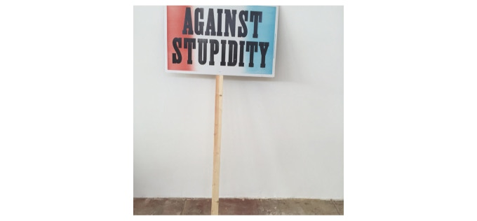 Against Stupidity, Daniel Joseph Martinez, 2016. Woodblock on screen-print, clay-coated cardboard 14 x 22 in. (35.56 x 55.88 cm.) Edition of 250 (Stick not included)